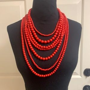 Red 7 strand beaded necklace